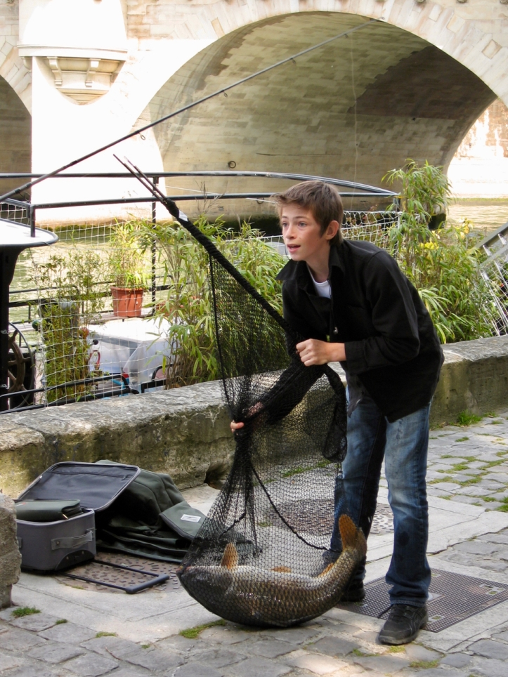 boy-with-fish-on-Seine-LaurieBest-photo
