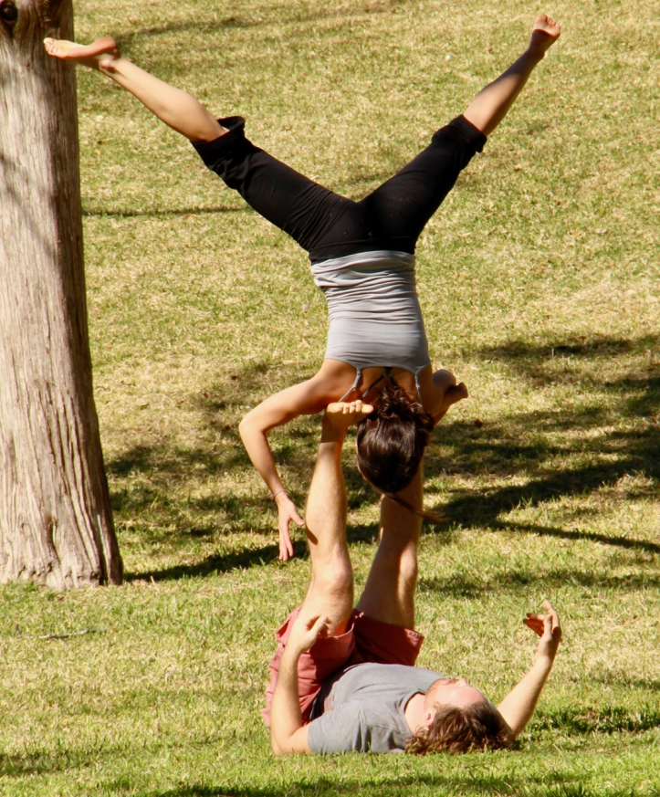 man balancing woman upside down laurie best photo