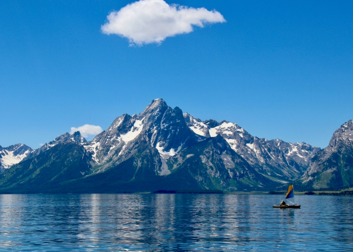 Grand Tetons with sailboat on Jackson Lake laurie best photo